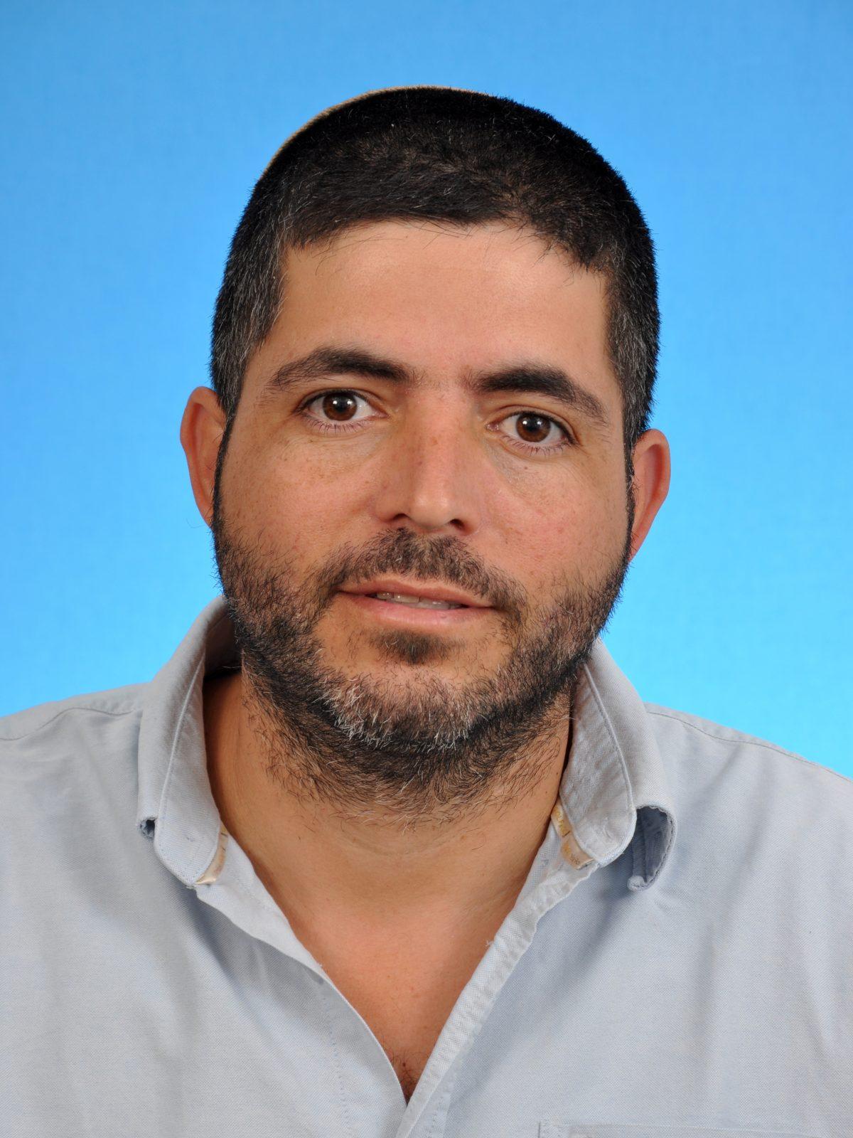 מנהל בית הספר שמעון אש